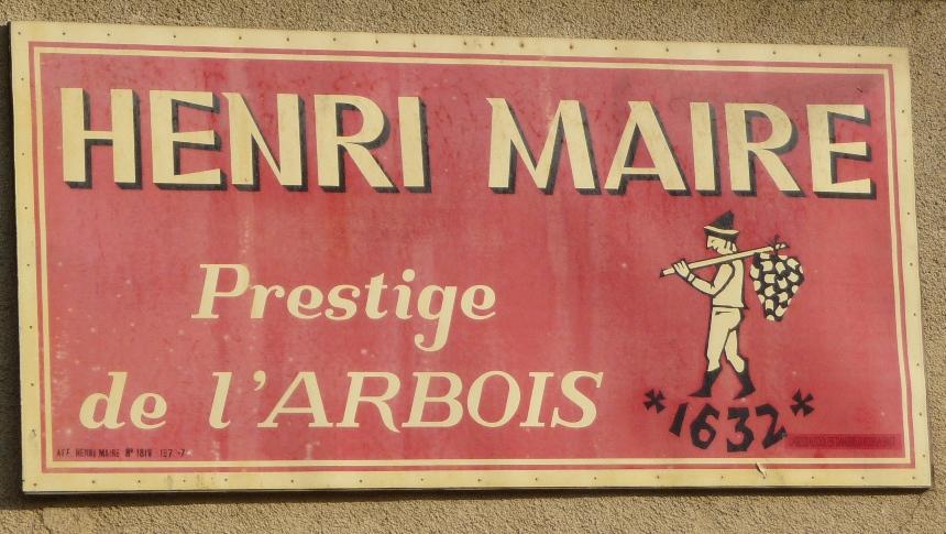 Old sign for Henri Maire